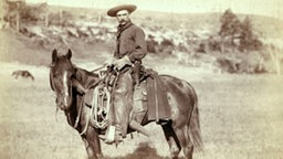 Wild West, Cowboy / Photo c.1887  History of the USA, 'The Wild West'. - Cowboy in South Dakota. - Photograph, c.1887/92 (John C.H. Grabill).