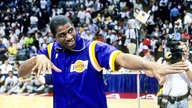 Magic Johnson in einem Trikot der Los Angeles Lakers im Jahr 1990.